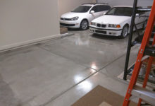 Thumbnail - garage floor epoxy coating - 2 white cars in background