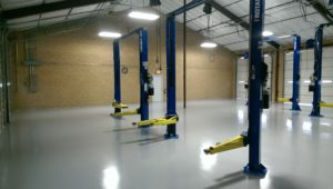 empty auto shop after floors have been refinished